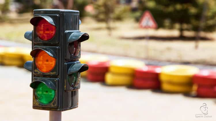 Red traffic light symbolising rules for fertility clinics in Australia